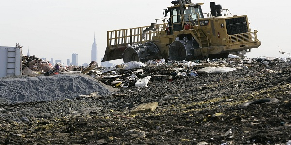 ** ADVANCE FOR SUNDAY, OCT. 26  **  A large tractor moves trash and garbage around on top of  1-E landfill in Kearny, N.J., Monday, Oct. 6, 2008. The Kearny site is among 21 landfills in New Jersey that convert methane gas produced by decomposing trash into electricity, according to the state Board of Public Utilities.  (AP Photo/Mike Derer)